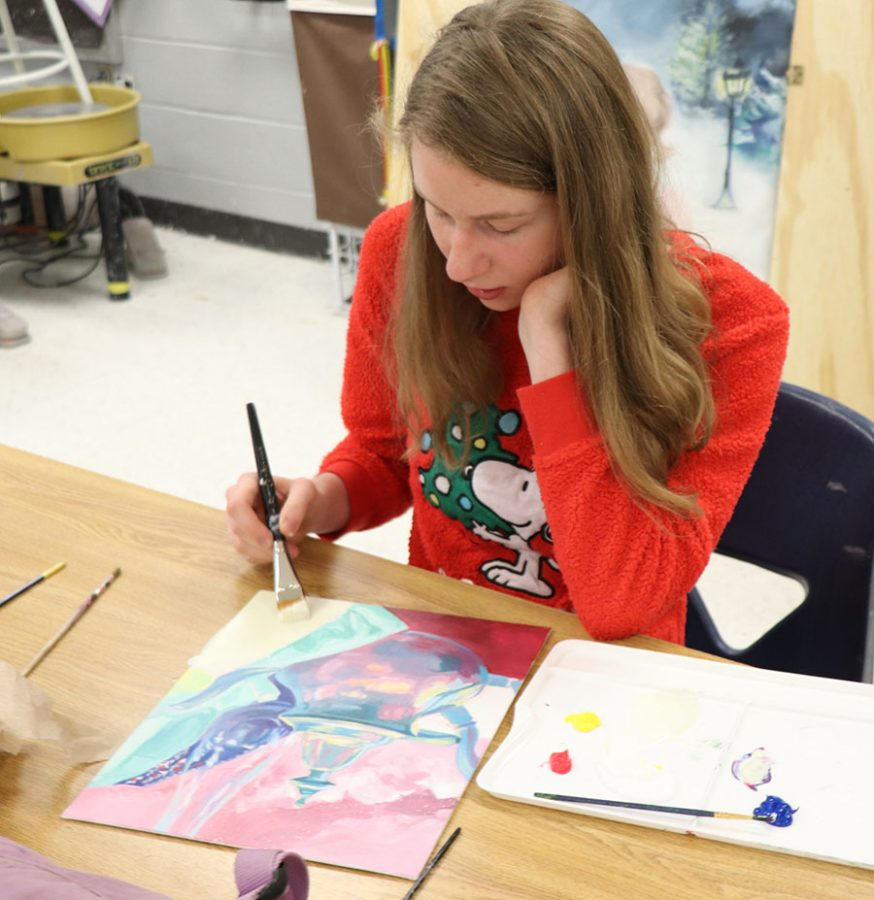 Junior Julia White works on her current illustrative art piece.