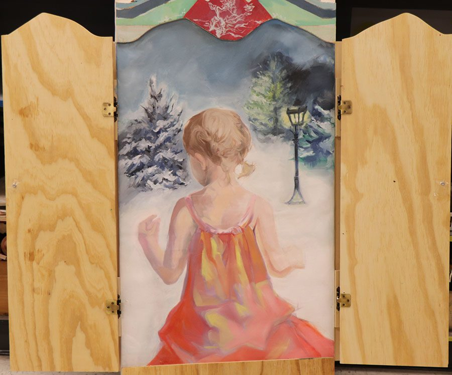 Junior Julia White's art piece is a Childhood Tribute for the upcoming showcase.  Her art represents a young girl entering the woods through a wardrobe. A scene from The Lion, The Witch, and The Wardrobe written by C.S. Lewis.