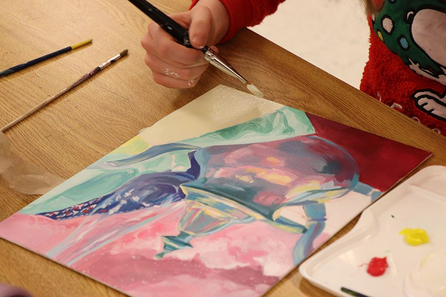 White adds detail before completing her work.
