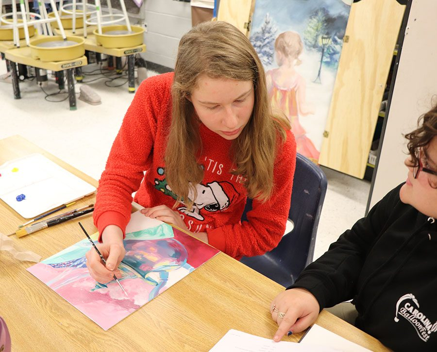 Julia White gets a couple tips from her classmate,  Maggie Botticelli.