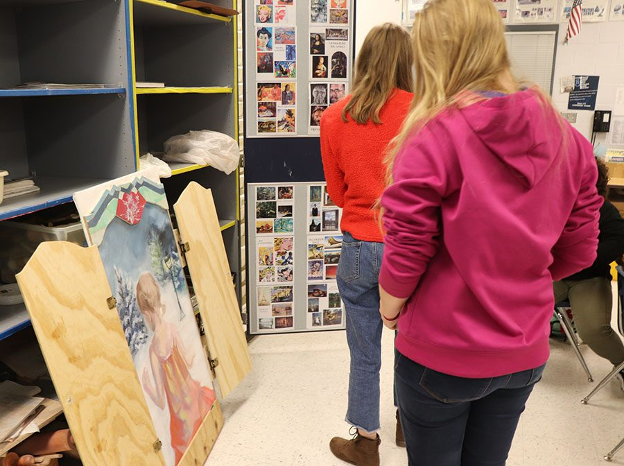 Students observe Julia White's upcoming showcase piece.