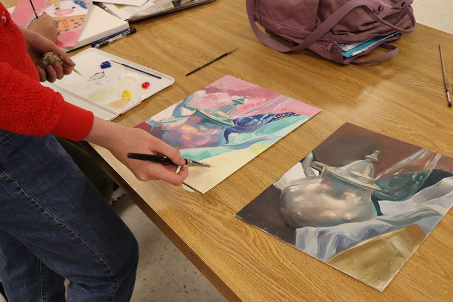 Julia White checks to see if certain details from the two pieces match.