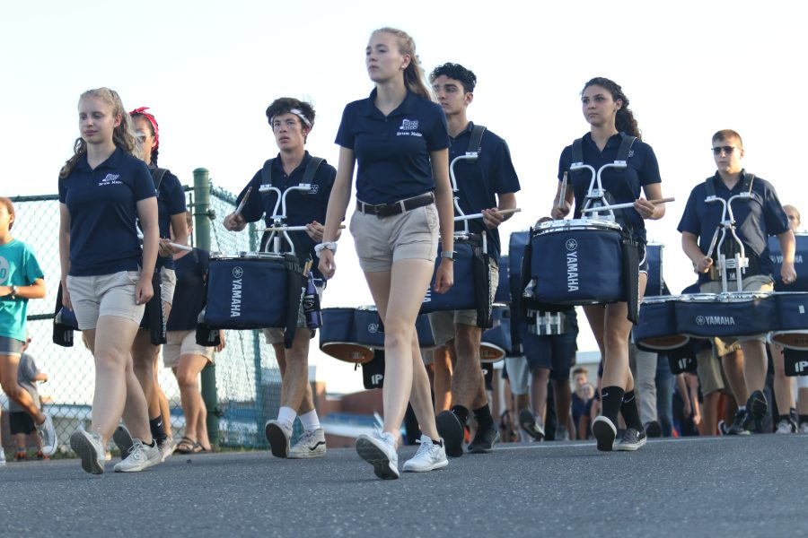 Seniors+and+band+leaders+Alice+McNett+and+Claudia+Obenschain+lead+the+marching+band+to+the+football+field+during+a+home+football+game.+