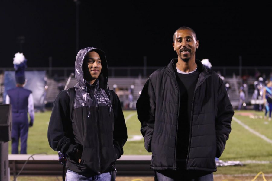 Sophomore Xavier Cain and his dad walk out at halftime.