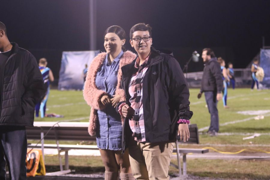 Junior Cesar Diaz is  escorted by co-worker Christian Willingham.