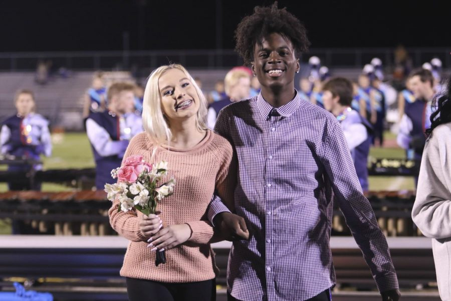 Seniors Cam'Ron Stuart and Abbey Fisher walk out together.
