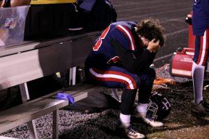 Varsity football loses district championship game 54-7