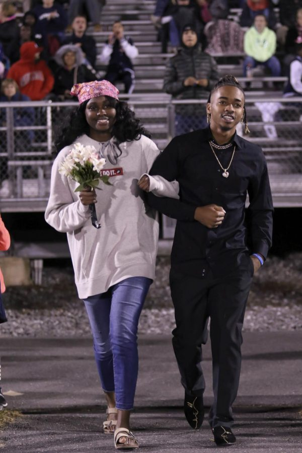 Seniors Atilia Thomas and Frederick Reed walk out together at halftime.