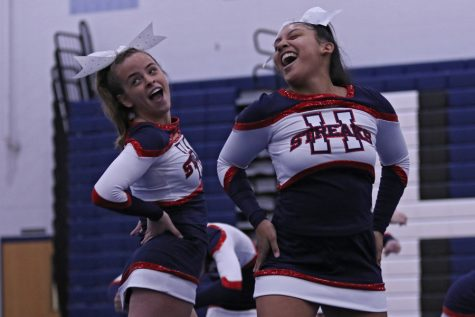 Sophomores Clara Miller and Genesis Martinez smile as they perform.