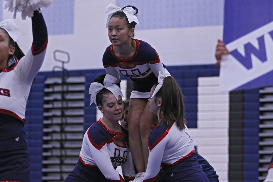 Junior Ruby Arndt prepares to be lifted into a stunt.