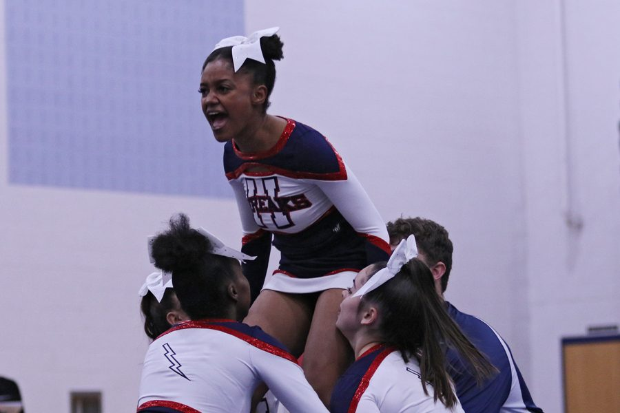 Junior Nissi Gotay prepares to be lifted into a stunt.