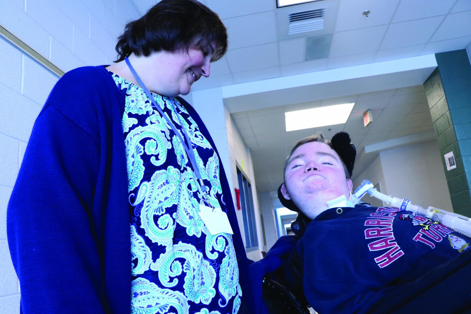 """Jimmy Barnes works with his nurse, Karen Zirk throughout the day. Shifflett stays with Barnes from 7 in the morning to 3 in the afternoon. """"I started working with Jimmy six years ago [and] not much has changed other than him losing a little more body function,"""" Shifflett said. """"He used to be able to do his right elbow and move it back, [but] he slowly lost that function."""""""