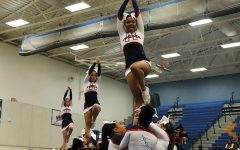 Competition cheer moves on to second round of regionals