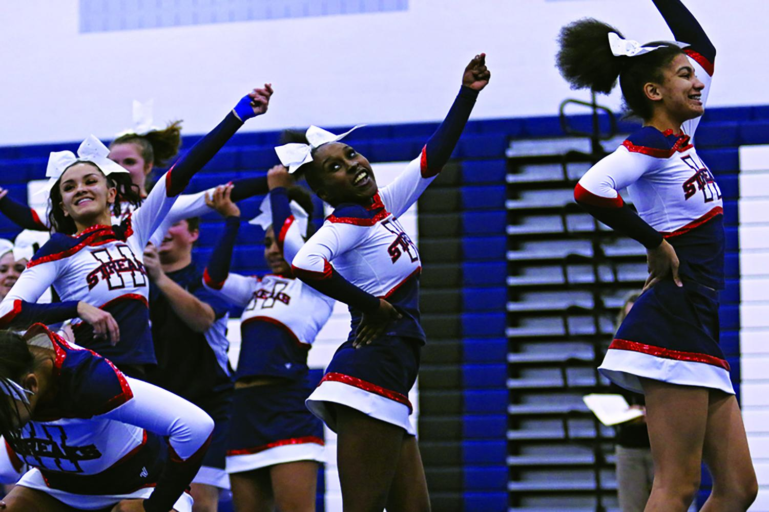 Junior Dorothy Yates competes in one of her many cheer competitions of this season. This year the cheer team placed second at districts.