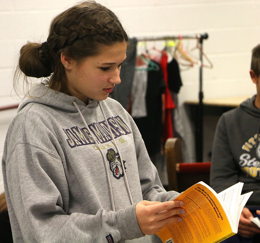 Freshman Ella Young looks for a monologue for her upcoming audition.