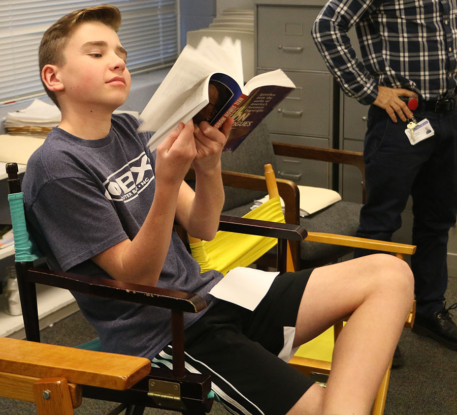 Freshman Owen Wells skims through a book of monologues to find a monologue that he may use for his upcoming musical audition.