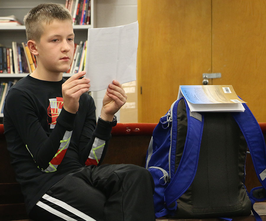 Freshman Evan Eberly reads over monologues.