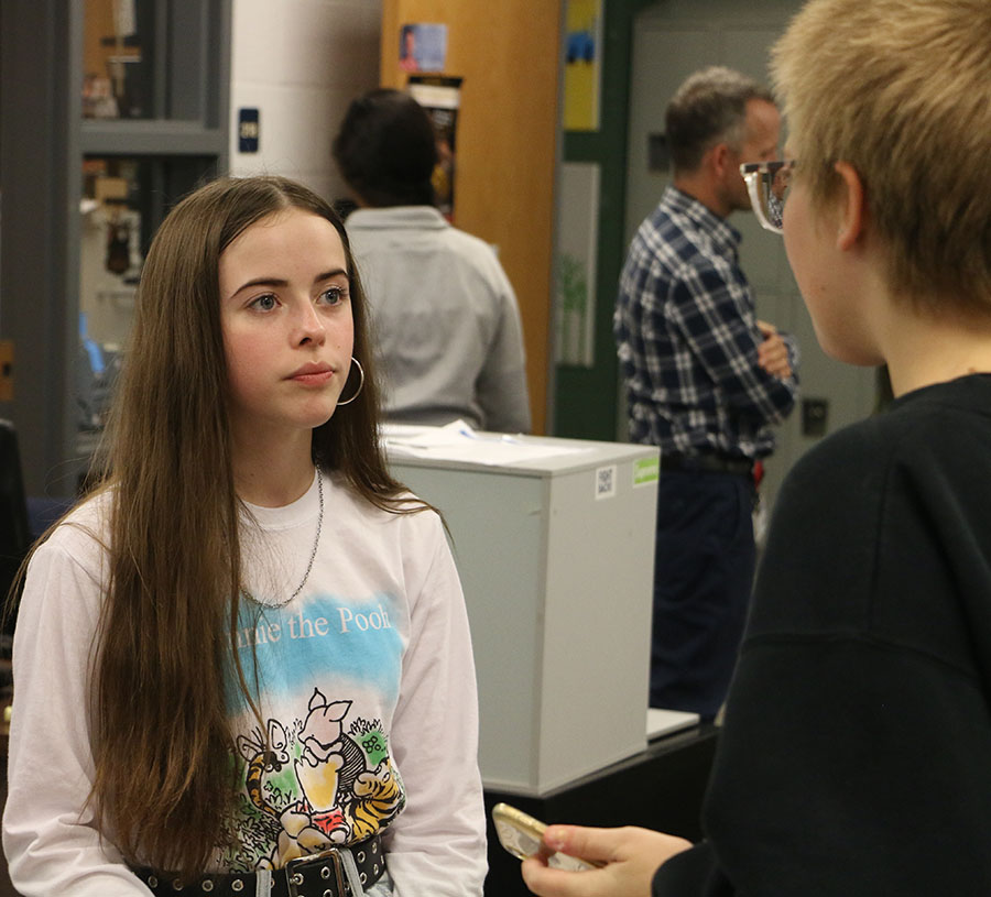 Freshman Kate Nichols (left) gets monologue tips from freshman Ellie Peeks (right).