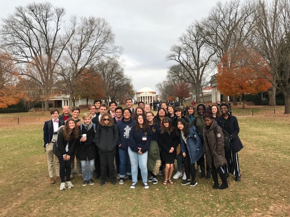 Students attend the Model UN conference and take a picture in front of the Rotunda.