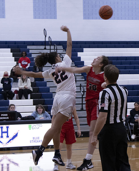 Sophomore Jay Vega-Garcia wins the jump ball at the start of the game against Albemarle High School.
