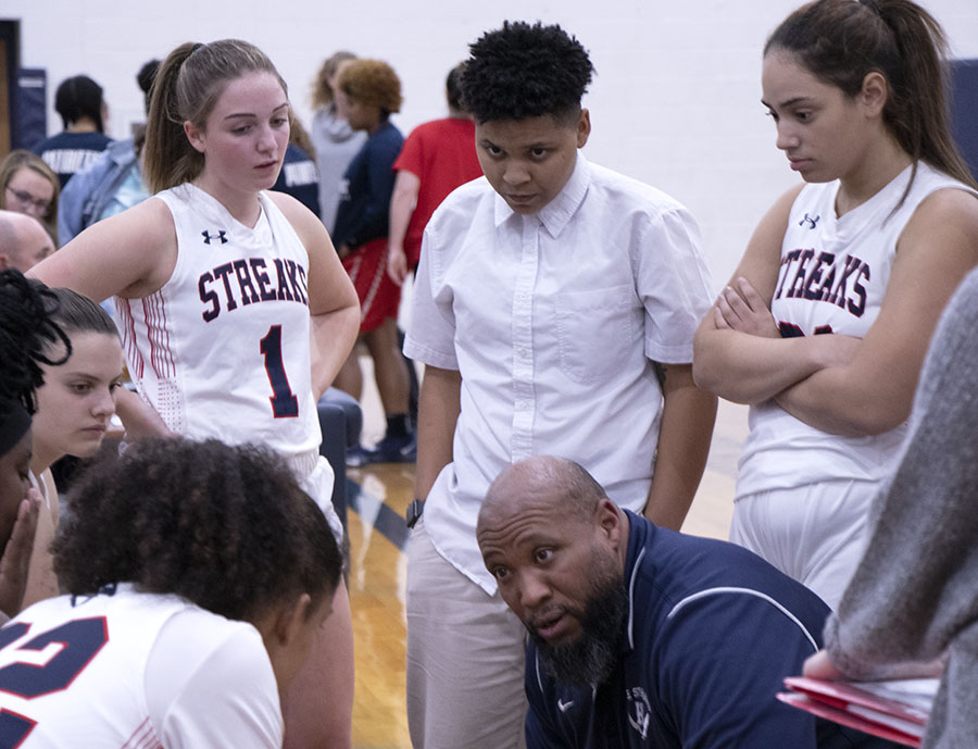 Coach+Durmount+Perry+talks+to++the+girls+basketball+team+during+a+timeout.