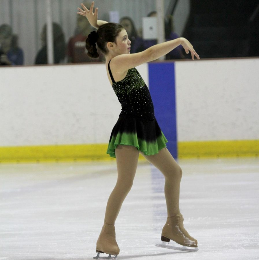 Grace+Miller+performs+a+figure+skating+routine+as+a+child.+