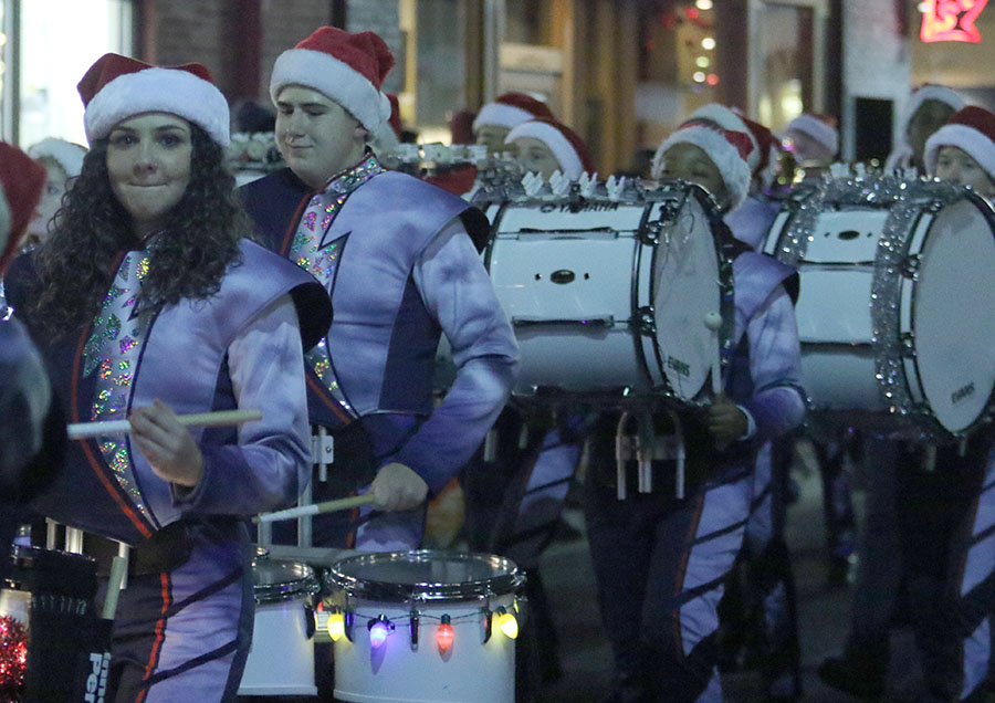 Sophomore Layla Seefried, left, plays drums for the Holiday Parade.