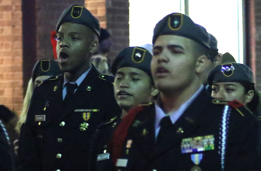 Freshman Joseph Adams attends the Holiday Parade along with JROTC.