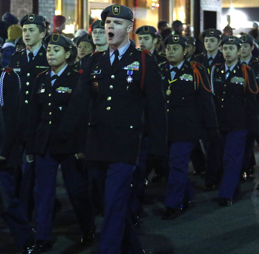 Junior Parker Fiske keeps JROTC on step by shouting pout chants.
