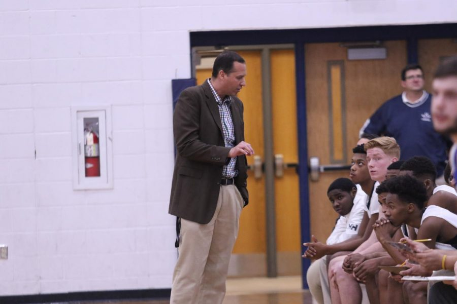 Basketball coach Don Burgess gives his players a pep talk during the Jan. 9 game against Rockbridge.