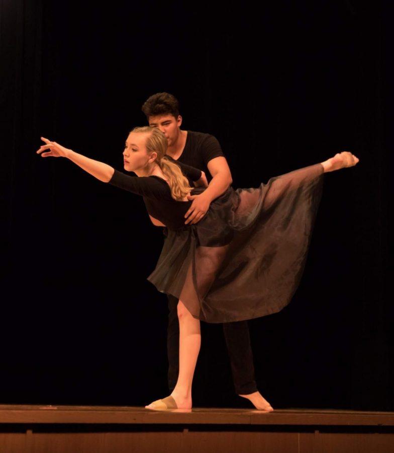 Senior Claudia Obenschain preforms for her dance 4 honors project with her partner senior Winston Lobo.
