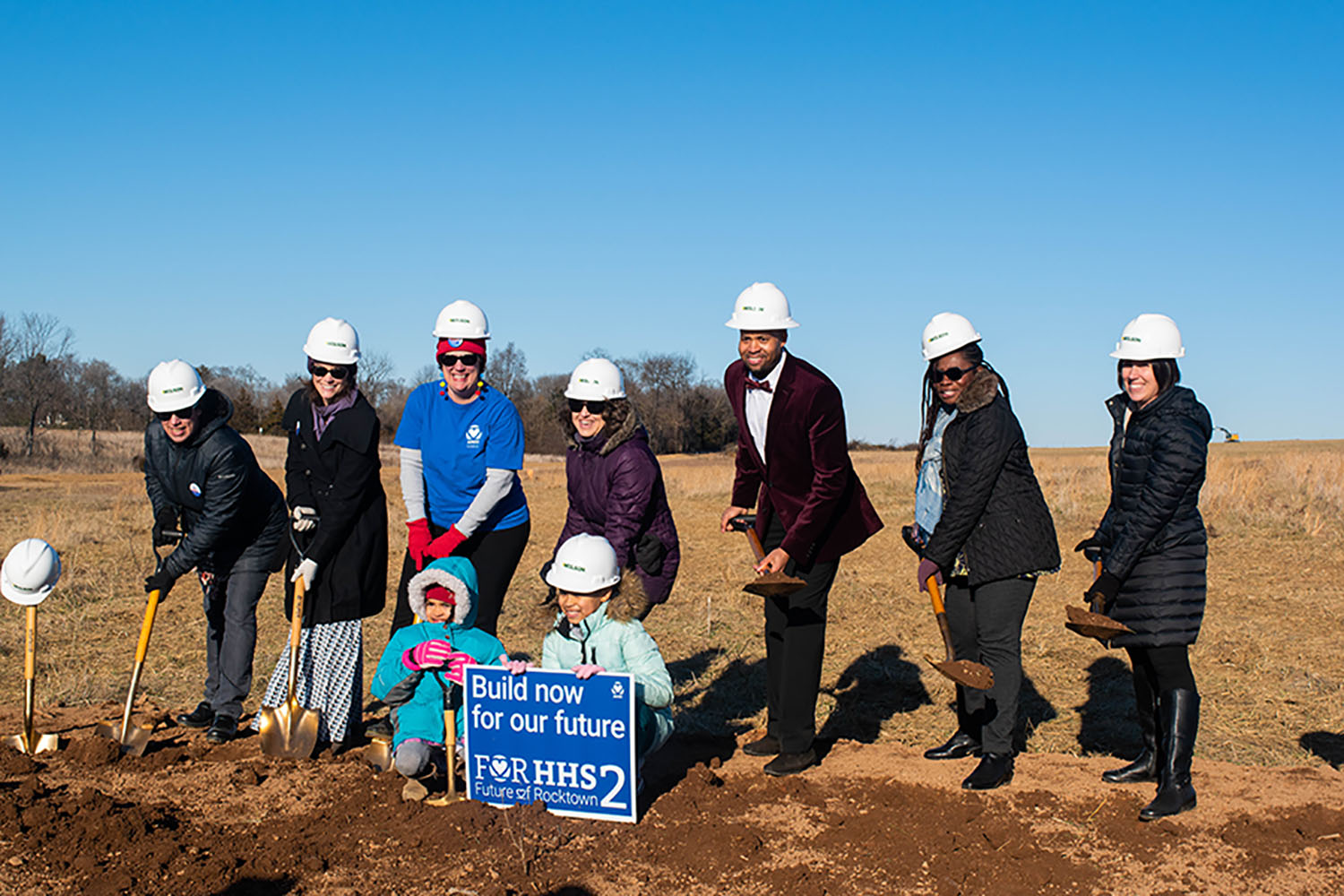Representatives of the For HHS2 group dig into the ground at the new site. Members of the community and city council attended the event to celebrate the start of the construction of the new high school.