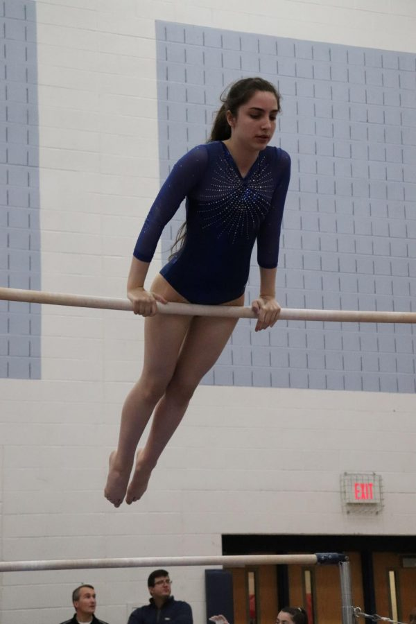 Freshman+Mary+Hermes+competes+on+bars+at+the+home+gymnastics+invitational.