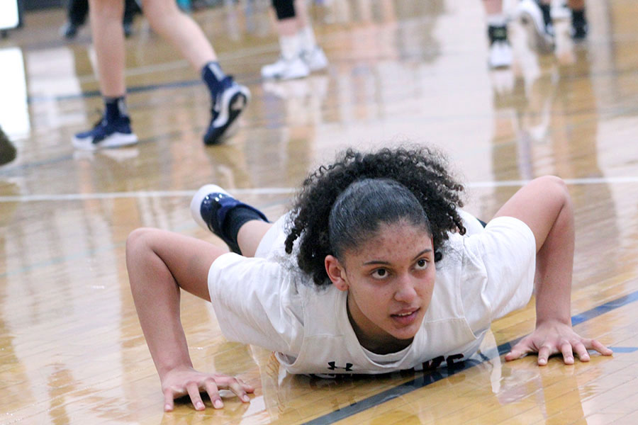 Sophomore Jay Garcia sprains her ankle after going for the ball.