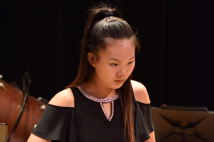 Sophomore Jeslyn Liu plays the Marimba during a percussion band concert.