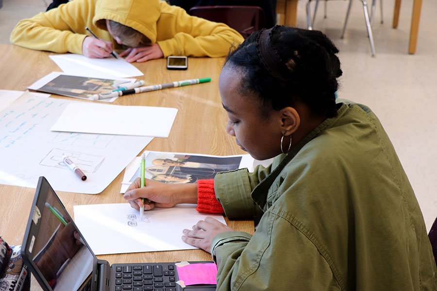 Senior Jayla Rudd works on a piece of art on her first day of art class.
