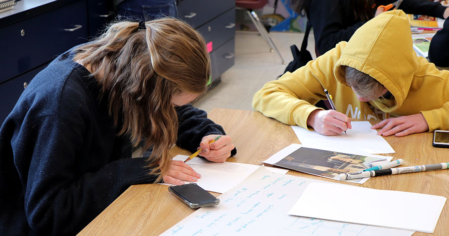 Sophomores Rose Trainum and Philip Levchuk work on their art pieces.