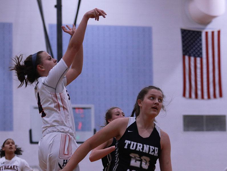 Sophomore Ellie Muncy shoots the ball towards the hoop.