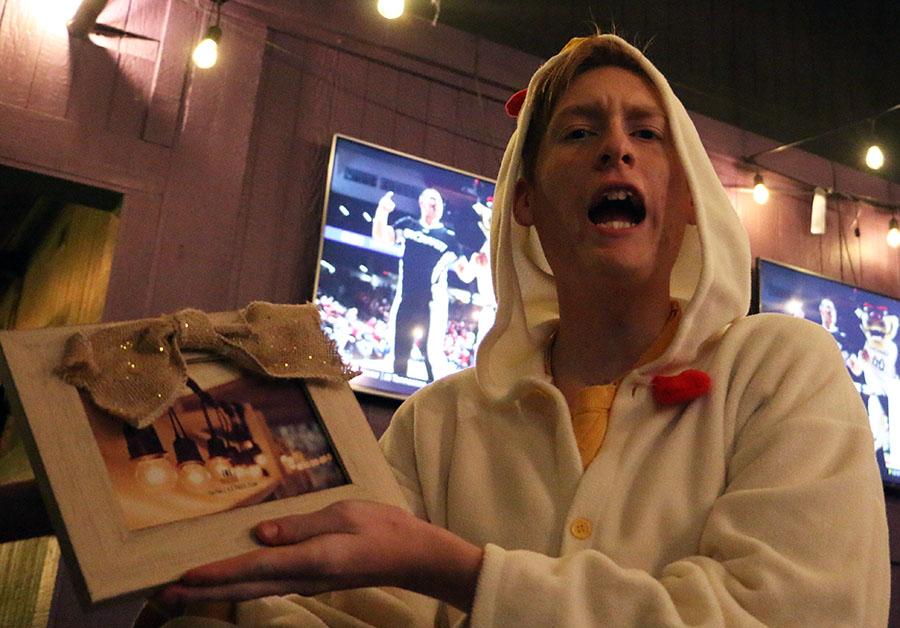 Newsstreak editor junior Caleb Goss gets a picture frame as a gift.