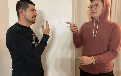 Junior Jesus Cortes communicates with his father using Spanish Sign Language.