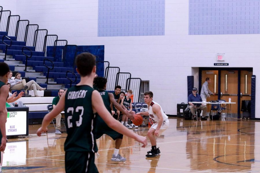 Sophomore Dylan Burnette takes the ball down the court.