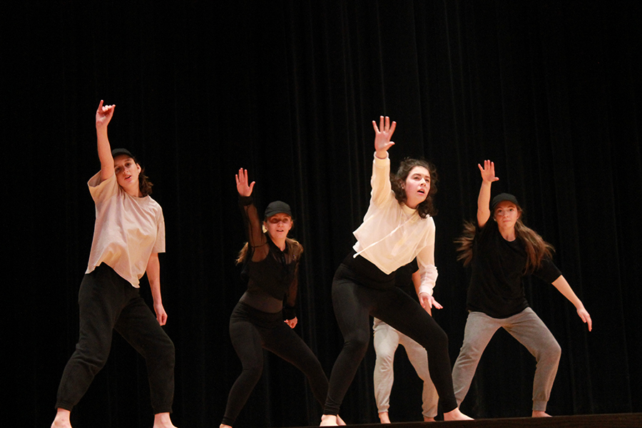 Sophomore+Zoelle+Bleazard%2C+senior+Carly+Corso%2C+and+juniors+Cecelia+Thomas+and+Sydney+Shaver+dance+represent+the+bare+emotions+in+Thomas%27s+mind+in+a+dance+choreographed+by+Thomas.