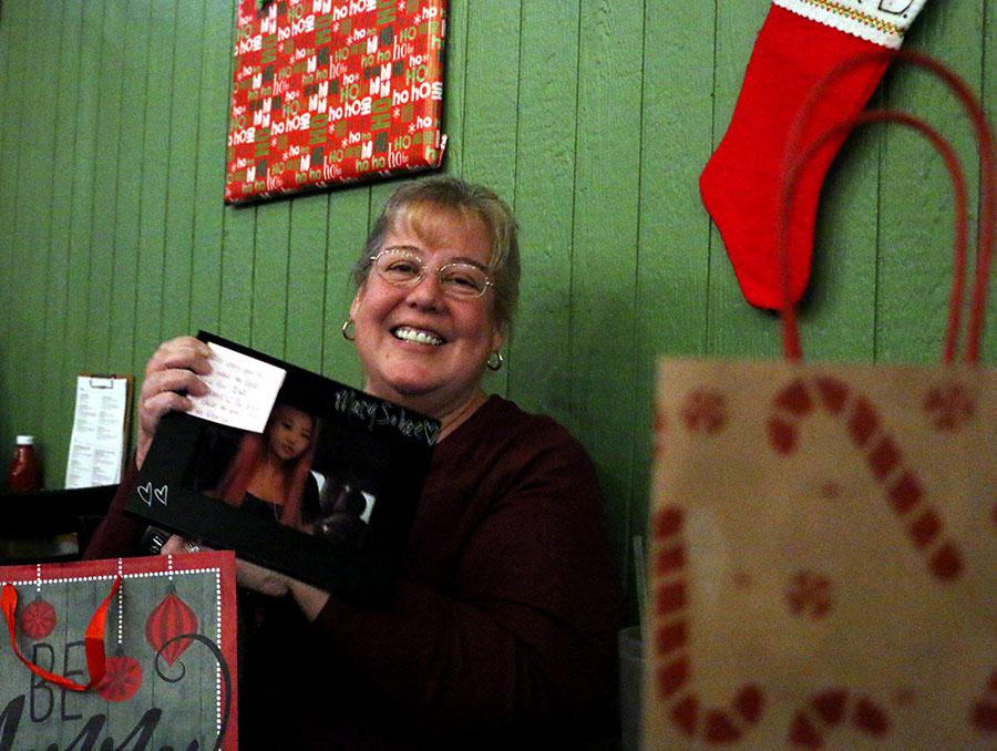 Journalism adviser Valerie Kibler steals a picture of Swift from  Tandel.