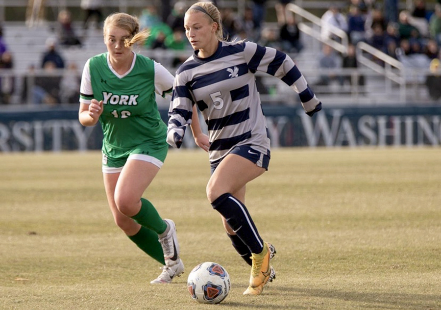 2019 alumna Mikaela O'Fallon dribbles down the field during a game against York College of Pennsylvania Oct. 12.  O'Fallon now plays soccer for the University of Mary Washington in Fredericksburg, Va.
