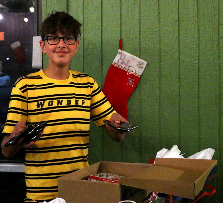 Newsstreak staff reporter freshman Nico Samatar receives a box full of iPhone 3gs.
