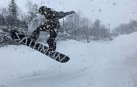 Junior Thomas Shulgan hits a jump on Diamond Jim at Massanutten Ski Resort.