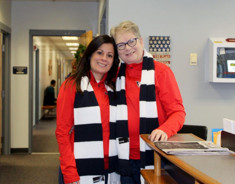 Gloria Figueroa and Beth Cash pose wearing matching HHS Christmas apparel.