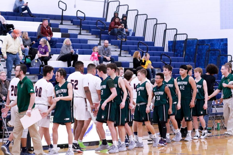 After a loss against the Gobblers, the JV boys shake hands.