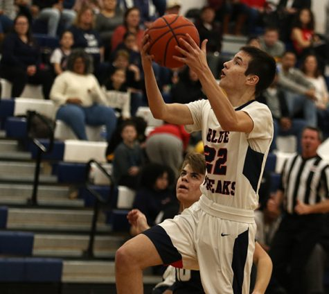 Junior Jesse Lichti goes for a lay-up during the 3rd period of the game.