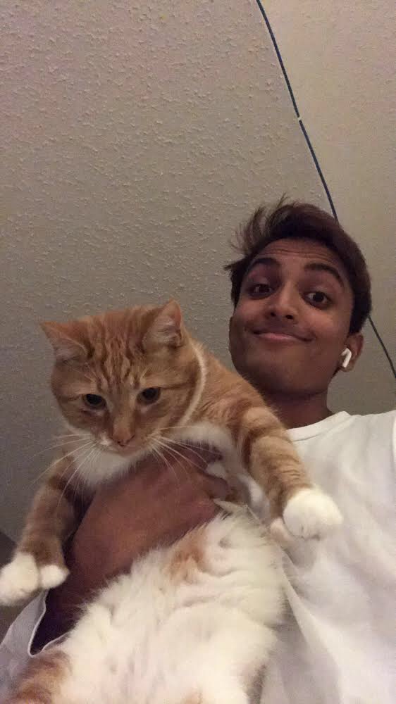 Junior Sid Tandel holds his cat, Squeaky.